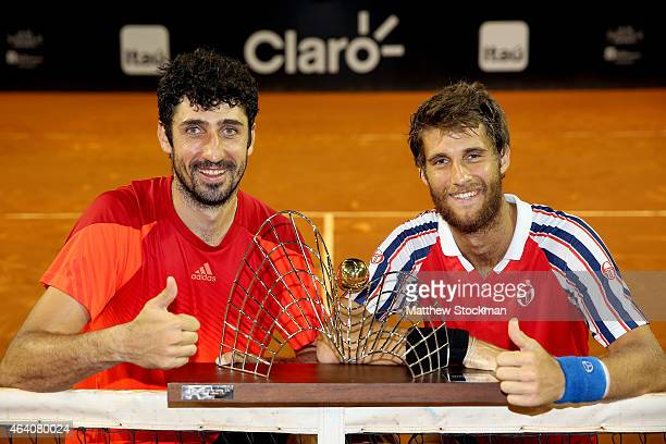 Philipp Oswald of Austria and Martin Klizan of Slovakia pose for photographers after defeating Pablo Andujar and Oliver Marach to win the doubles...