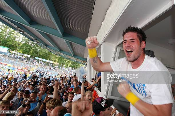 Philipp Pentke of Chemnitz celebrates with supporters after winning the Regionalliga North match between Chemnitzer FC and RB Leipzig at Stadion an...