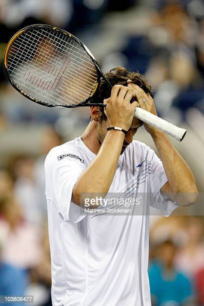 Philipp Petzschner Germany reacts to losing his match against Novak Djokovic of Serbia during day four of the 2010 U.S. Open at the USTA Billie Jean...