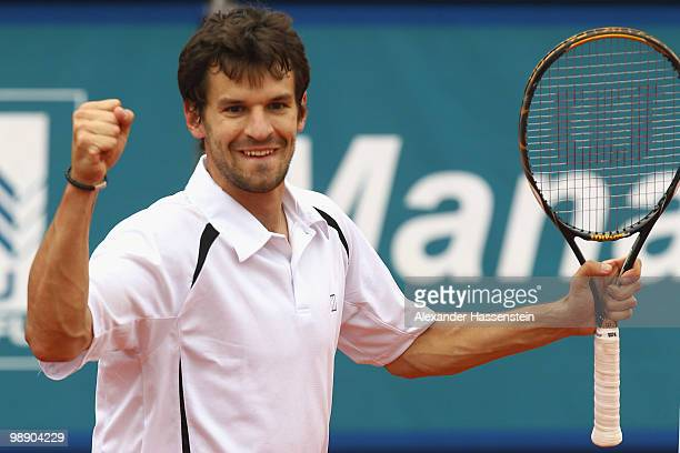 Philipp Petzschner of Germany celebrates winning his match against Tomas Berdych of Czech Republic on day 6 of the BMW Open at the Iphitos tennis...