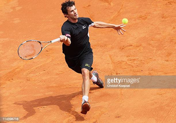 Philipp Petzschner of Germany palys a forehand plays a backhand during the blue group match between Philipp Petzschner of Germany and Igor Andreev of...