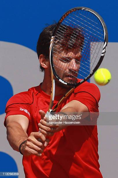 Philipp Petzschner of Germany plays a back hand during his quarterfinal match against Potito Starace of Italy at BMW Open at the Iphitos tennis club...