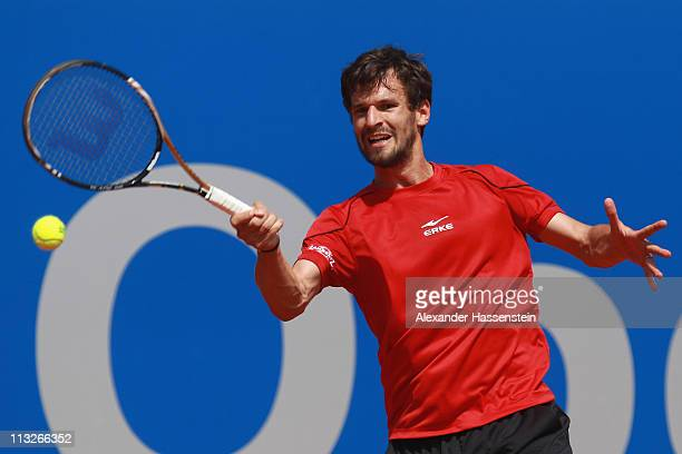 Philipp Petzschner of Germany plays a fore hand during his quarterfinal match against Potito Starace of Italy at BMW Open at the Iphitos tennis club...