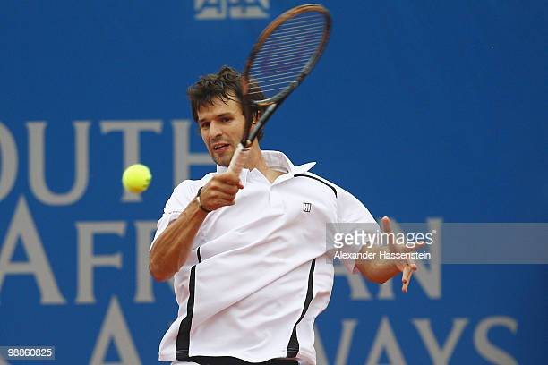 Philipp Petzschner of Germany plays a forehand during his match against Daniel Koellerer of Austria at day 4 of the BMW Open at the Iphitos tennis...