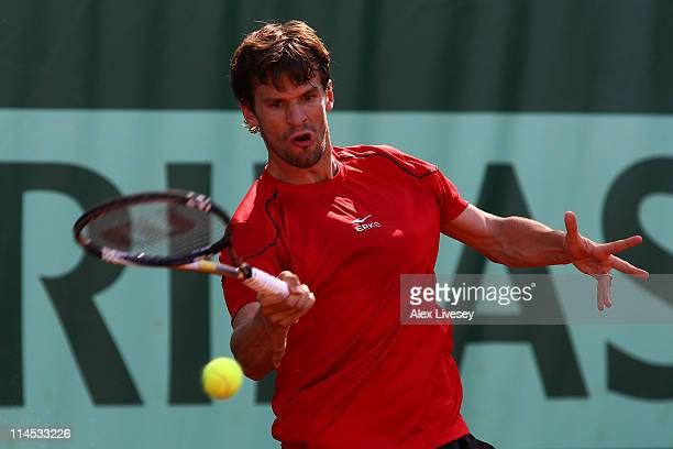 Philipp Petzschner of Germany plays a forehand during the men's singles first round match between Philipp Petzschner of Germany and Mischa Zverev of...