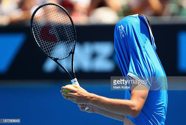 Philipp Petzschner of Germany reacts after a point in his second round match against Milos Raonic of Canada during day four of the 2012 Australian...