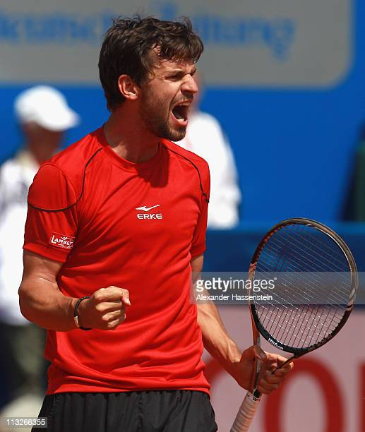 Philipp Petzschner of Germany reacts after winning his quarterfinal match against Potito Starace of Italy at BMW Open at the Iphitos tennis club on...