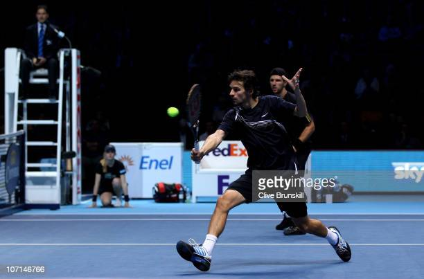 Philipp Petzschner of Germany returns the ball while playing with Jurgen Melzer of Austria during their men's doubles match against Mariusz...