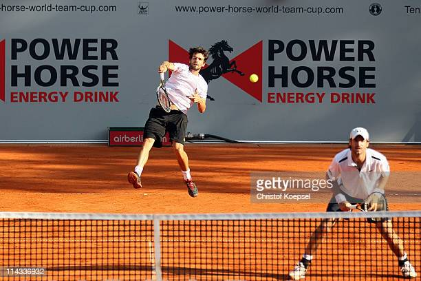 Philipp Petzschner of Germany serves during the match between Philipp Petzschner and Christopher Kas and Marcel Granollers and Marc Lopez of Spain in...