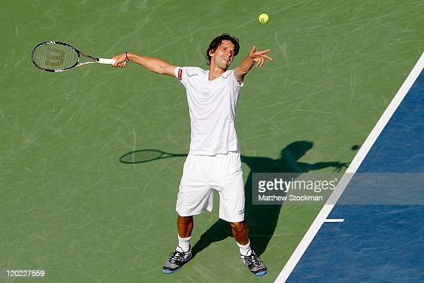 Philipp Petzschner of Germany serves to Radek Stepanek of the Czech Republic during the Legg Mason Tennis Classic presented by Geico at the William...