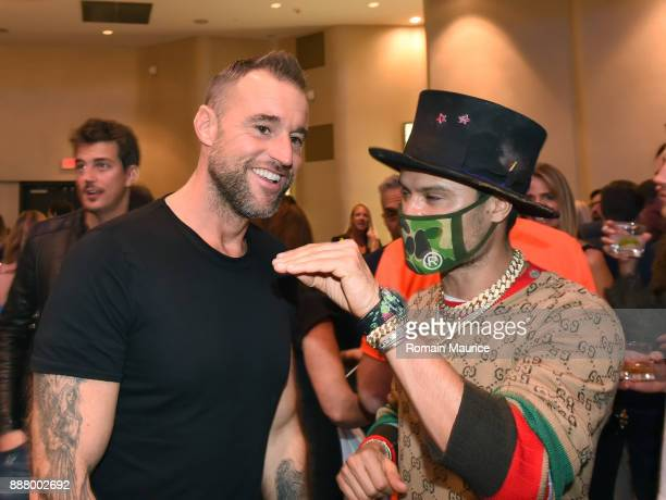 Philipp Plein and Alec Monopoly attend Haute Living's VIP PopUp Opening Of Alec Monopoly From Art Life And David Yarrow From Maddox Gallery at Fleur...