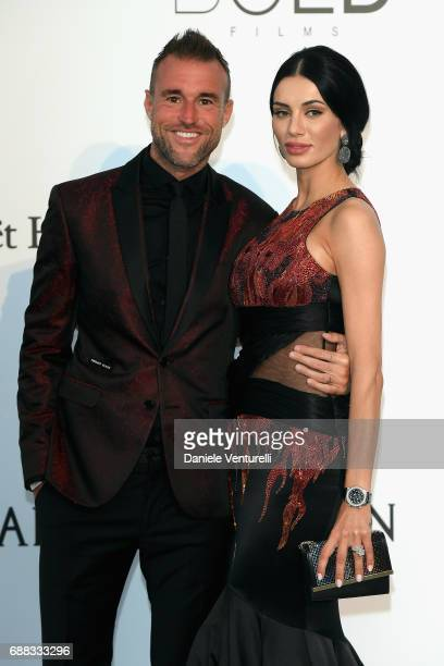 Philipp Plein and Andreea Sasu arrive at the amfAR Gala Cannes 2017 at Hotel du CapEdenRoc on May 25 2017 in Cap d'Antibes France