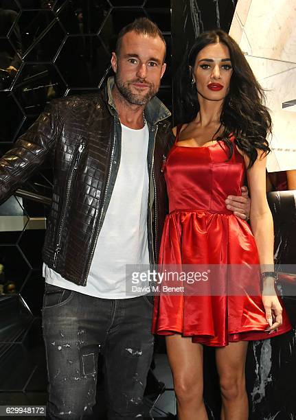 Philipp Plein and Andreea Sasu attend a cocktail party hosted by Philipp Plein to celebrate the opening of the Philipp Plein London boutique on...