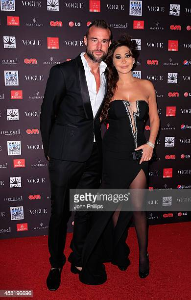 Philipp Plein and Elissa attend the Gala Event during the Vogue Fashion Dubai Experience on October 31 2014 in Dubai United Arab Emirates