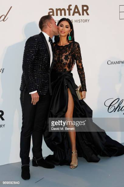 Philipp Plein and Morgan Osman arrive at the amfAR Gala Cannes 2018 at Hotel du CapEdenRoc on May 17 2018 in Cap d'Antibes France