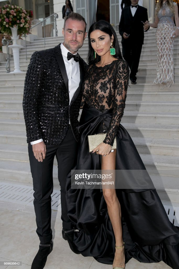 Phillip Plein and Morgan Osman attend the cocktail at the amfAR Gala Cannes 2018 at Hotel du Cap-Eden-Roc on May 17, 2018 in Cap d'Antibes, France.