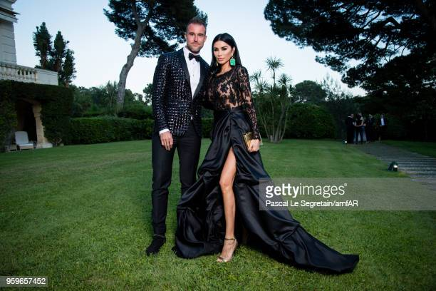 Philipp Plein and Morgan Osman pose for portraits at the amfAR Gala Cannes 2018 cocktail at Hotel du CapEdenRoc on May 17 2018 in Cap d'Antibes France