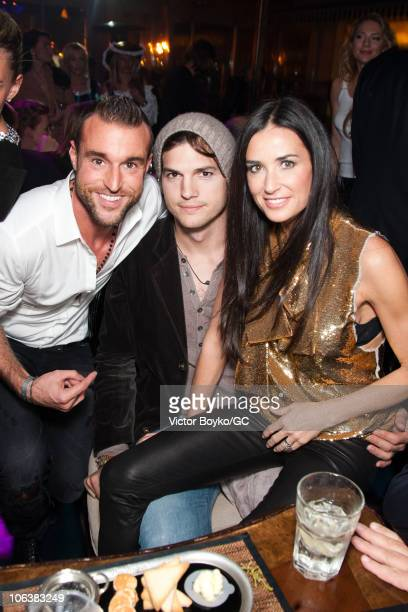 Philipp Plein Ashton Kutcher and Demi Moore attend the afterparty of the Charity Gala at The RitzCarlton on October 30 2010 in Moscow Russia