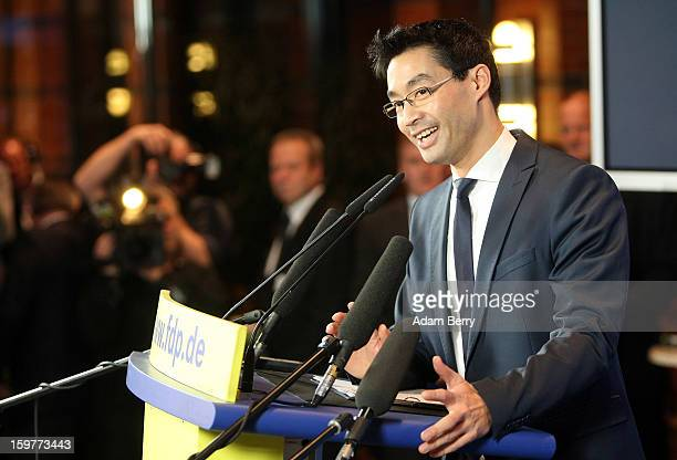 Philipp Roesler head of the Free Democratic Party and German economy minister gives a statement at the party's headquarters on January 20 2013 in...