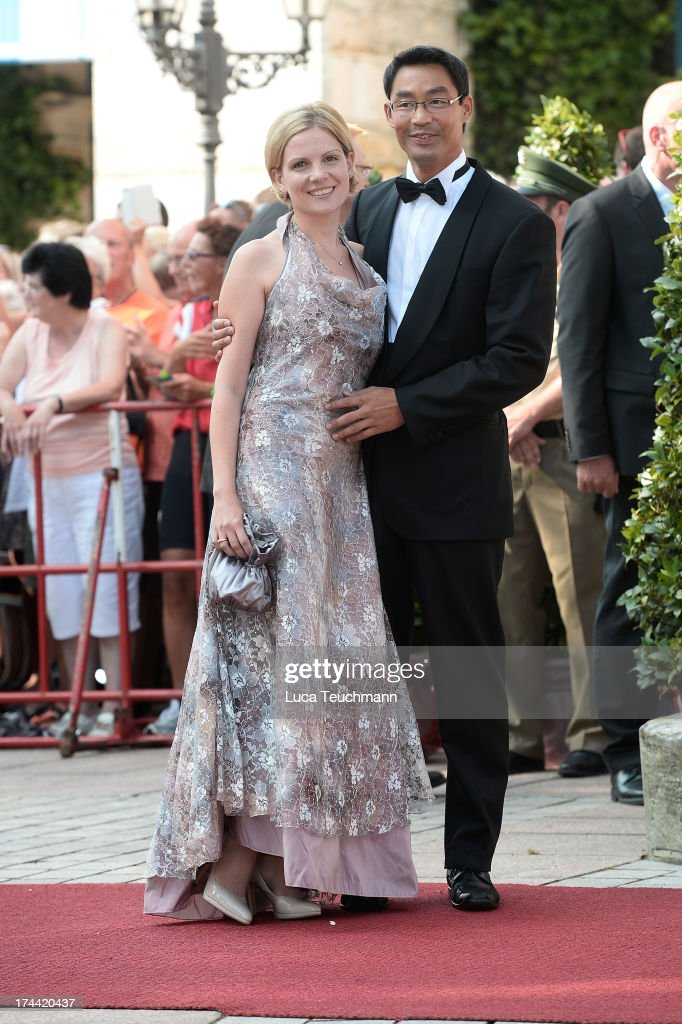 Philipp Roesler, Vice Chancellor and Chairman of the German Free Democrats (FDP) and his wife Wiebke attends the Bayreuth Festival opening on July 25, 2013 in Bayreuth, Germany.
