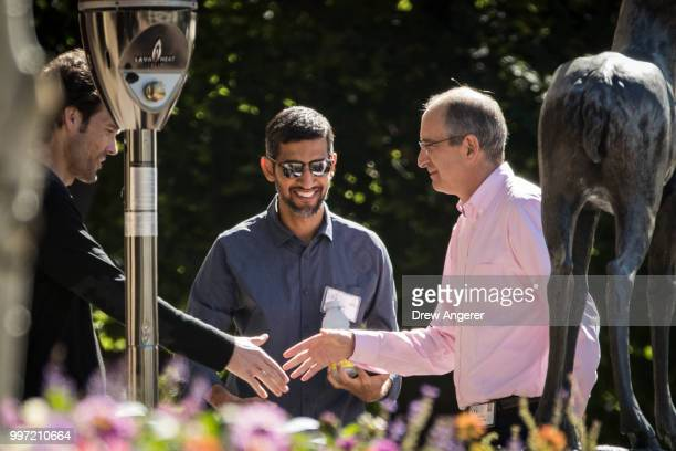 Philipp Schneider Sundar Pichai chief executive officer of Google and Brian Roberts chief executive officer of Comcast mingle with each other during...