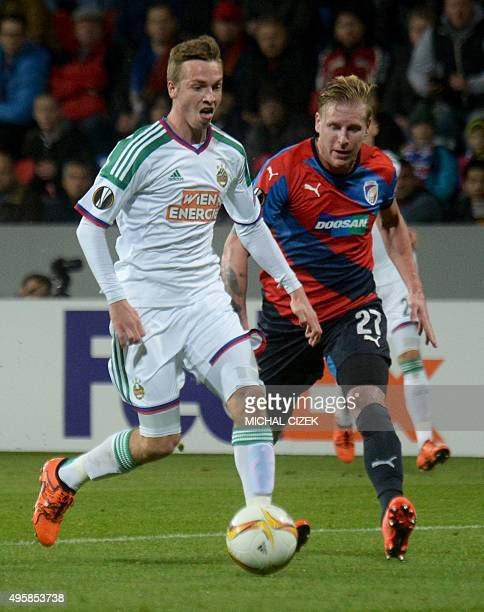 Philipp Sschobesberger of SK Rapid Wien and Frantisek Rajtoral of FC Viktoria Plzen vie for the ball during the UEFA Europa League football match FC...