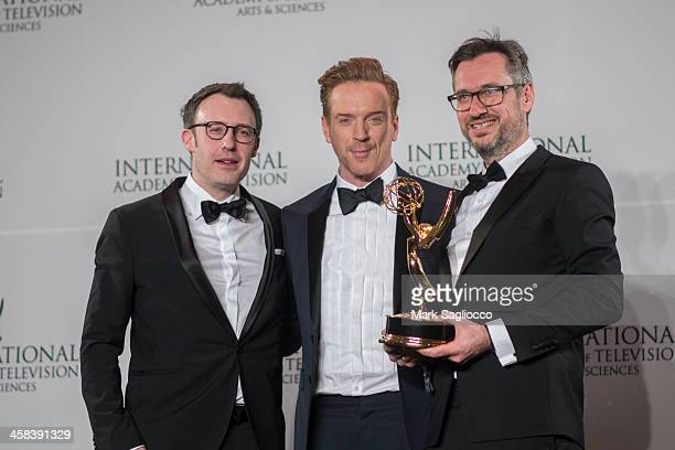 Philipp Steffens and Joerg Winger pose with the 'Drama Series' award in the press room with Damian Lewis during attend the 2016 International Emmy...