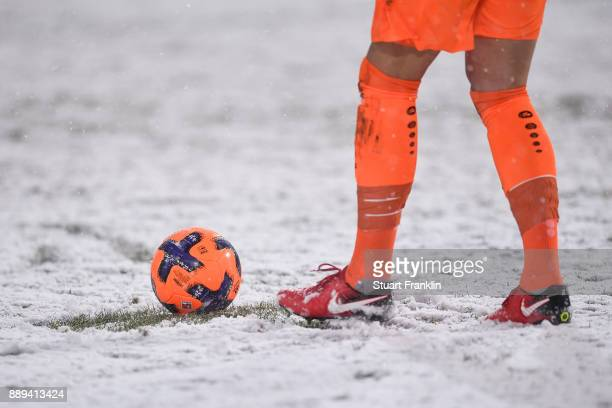 Philipp Tschauner of Hannover 96 kicks the ball during a heavy snow storm during the Bundesliga match between Hannover 96 and TSG 1899 Hoffenheim at...