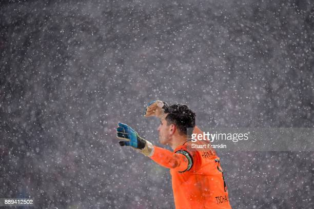 Philipp Tschauner of Hannover 96 looks ib during a heavy snow storm during the Bundesliga match between Hannover 96 and TSG 1899 Hoffenheim at...