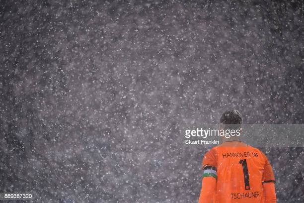 Philipp Tschauner of Hannover 96 stands during a heavy snow storm during the Bundesliga match between Hannover 96 and TSG 1899 Hoffenheim at HDIArena...