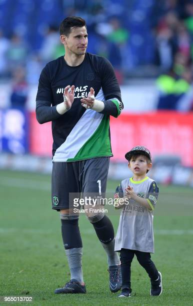 Philipp Tschauner of Hannover and child after the Bundesliga match between Hannover 96 and Hertha BSC at HDIArena on May 5 2018 in Hanover Germany