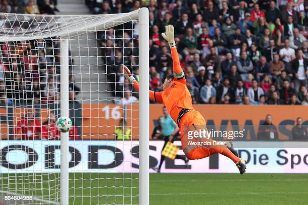 Philipp Tschauner of Hannover can't save a shot on his goal by Michael Gregoritsch of Augsburg which puts Augsburg in the lead 10 during the...