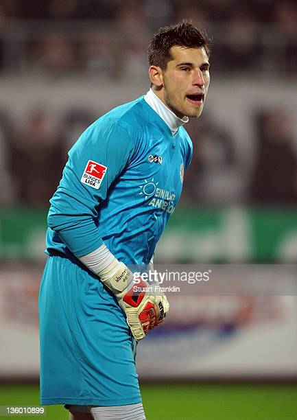Philipp Tschauner of St Pauli gestures during the Second Bundesliga match between FC St Pauli and Eintracht Frankfurt at the Millerntor stadium on...