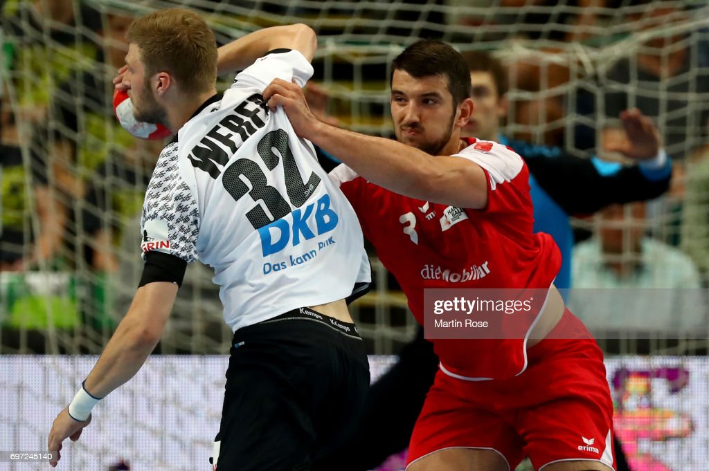 Philipp Weber #32 of Germany challenges Lucas Meister #3 of Switzerland during the 2018 EHF European Championship Qualifier between Germany and Switzerland at OVB-Arena on June 18, 2017 in Bremen, Germany.
