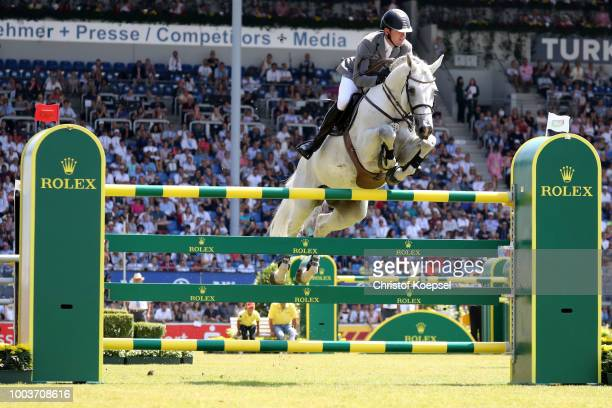 Luciana Dinz of Portugal rides on Fit for Fun 13 in the first round during the Rolex Grand Prix of CHIO Aachen 2018 at Aachener Soers on July 22 2018...