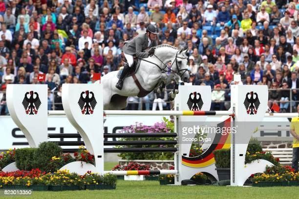 Philipp WEISHAUPT riding LB CONVALL during the Rolex Grand Prix part of the Rolex Grand Slam of Show Jumping of the World Equestrian Festival on July...