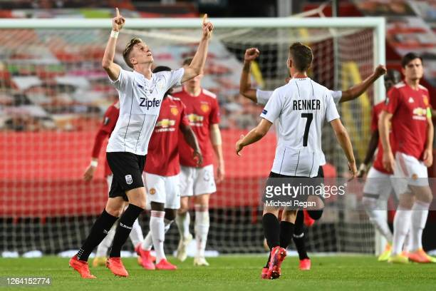 Philipp Wiesinger of LASK celebrates after scoring his sides first goal during the UEFA Europa League round of 16 second leg match between Manchester...