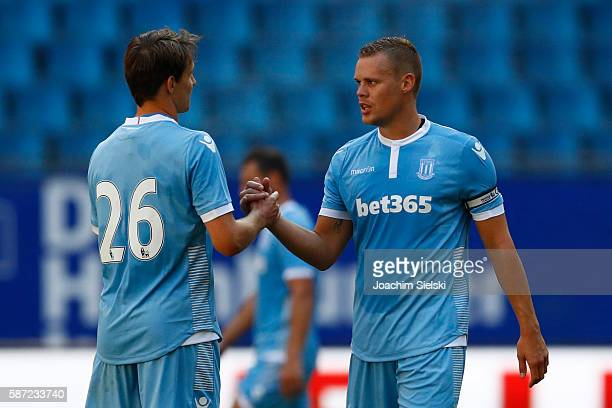Philipp Wollscheid and Ryan Shawcross of Stoke City after the preseason friendly match between Hamburger SV and Stoke City at Volksparkstadion on...