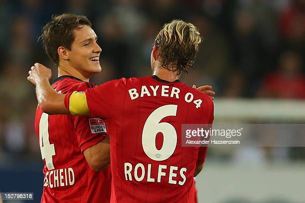 Philipp Wollscheid of Leverkusen celebrates scoring the second team goal with his team mate Simon Rolfes during the Bundesliga match between FC...