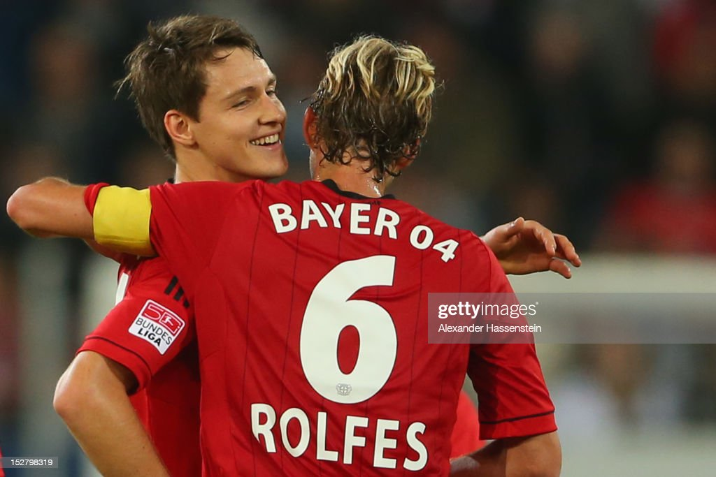 Philipp Wollscheid (L) of Leverkusen celebrates scoring the second team goal with his team mate Simon Rolfes during the Bundesliga match between FC Augsburg and Bayer 04 Leverkusen at SGL Arena on September 26, 2012 in Augsburg, Germany.