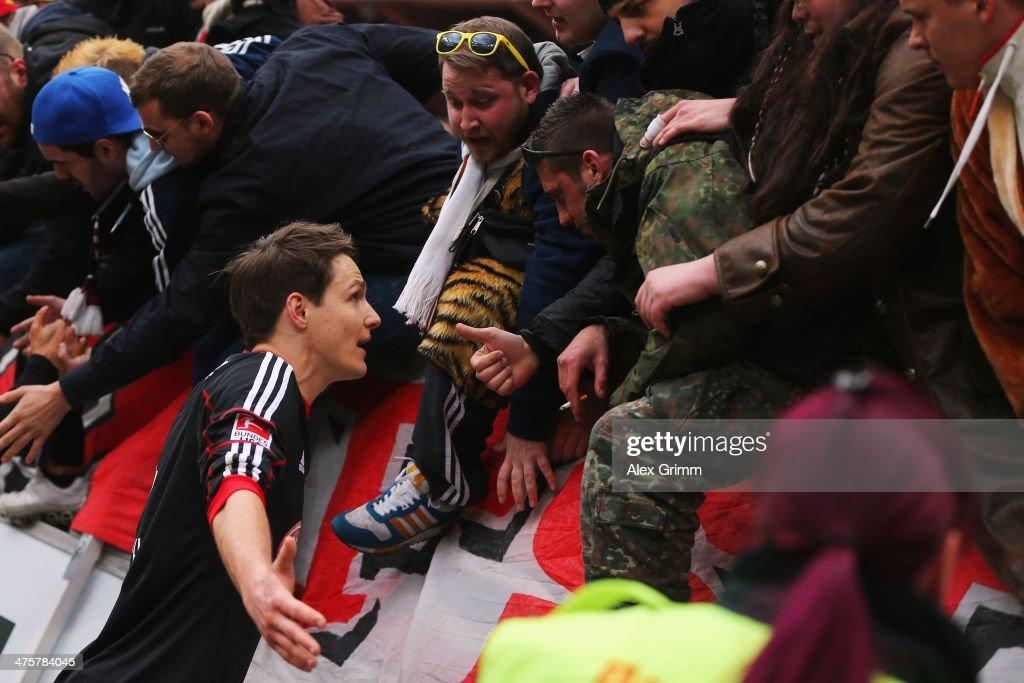 Philipp Wollscheid of Leverkusen discusses with the fans after the Bundesliga match between Bayer 04 Leverkusen and 1. FSV Mainz 05 at BayArena on March 1, 2014 in Leverkusen, Germany.