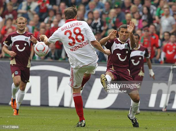 Philipp Wollscheid of Nuernberg battles for the ball with Altin Lala of Hannover during the Bundesliga match between Hannover 96 and 1 FC Nuernberg...