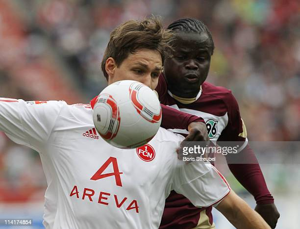 Philipp Wollscheid of Nuernberg battles for the ball with Didier Ya Konan of Hannover during the Bundesliga match between Hannover 96 and 1 FC...