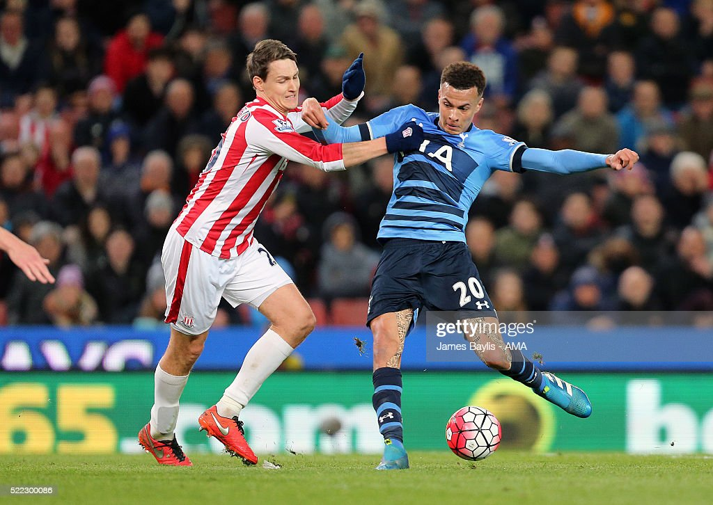Philipp Wollscheid of Stoke City and Dele Alli of Tottenham Hotspur during the Barclays Premier League match between Stoke City and Tottenham Hotspur at Britannia Stadium on April 18, 2016 in Stoke on Trent, England