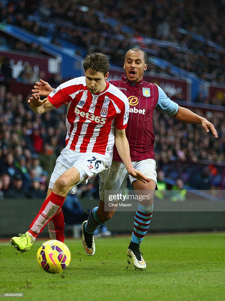 Philipp Wollscheid of Stoke City and Gabriel Agbonlahor of Aston Villa battle for the ball during the Barclays Premier League match between Aston Villa and Stoke City at Villa Park on February 21, 2015 in Birmingham, England.