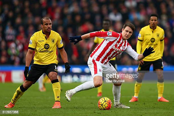 Philipp Wollscheid of Stoke City and Gabriel Agbonlahor of Aston Villa compete for the ball during the Barclays Premier League match between Stoke...