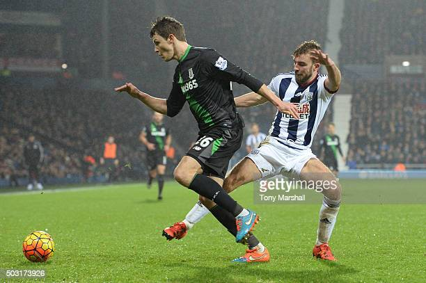 Philipp Wollscheid of Stoke City and James Morrison of West Bromwich Albion compete for the ball during the Barclays Premier League match between...