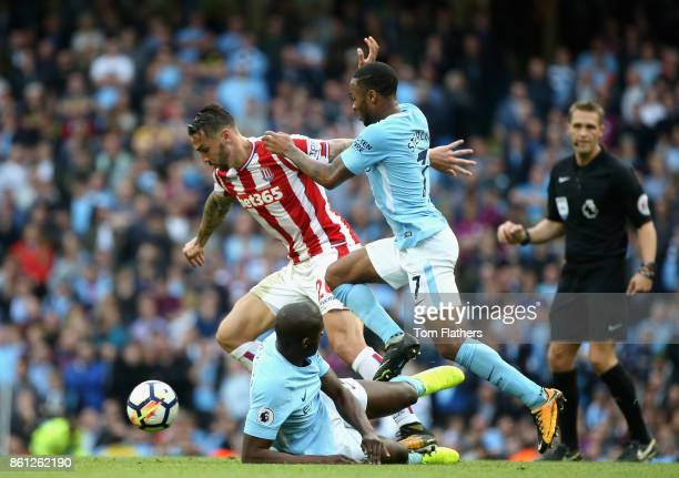 Philipp Wollscheid of Stoke City and Raheem Sterling of Manchester City battle for possession during the Premier League match between Manchester City...
