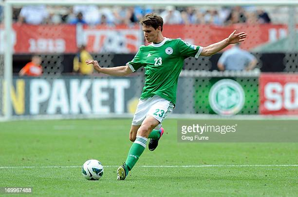 Philipp Wollscheid of the Germany Men's National Team passes the ball against the United States Men's National Team in an international friendly at...