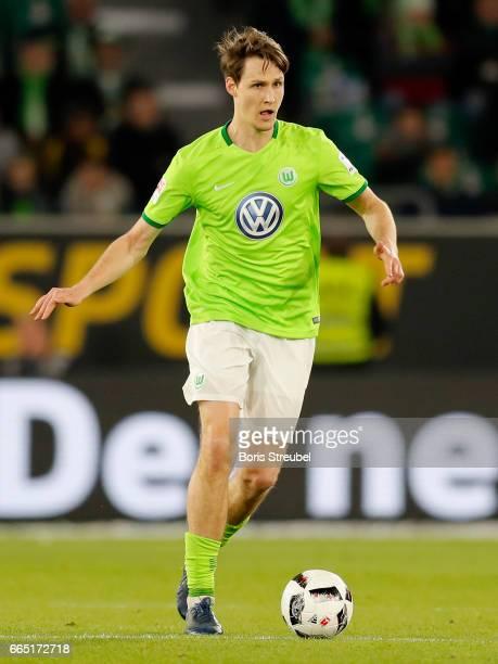 Philipp Wollscheid of VfL Wolfsburg runs with the ball during the Bundesliga match between VfL Wolfsburg and SC Freiburg at Volkswagen Arena on April...